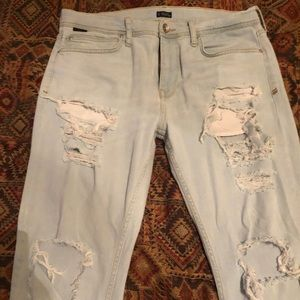 Men's light blue distressed (ripped) jeans size 34